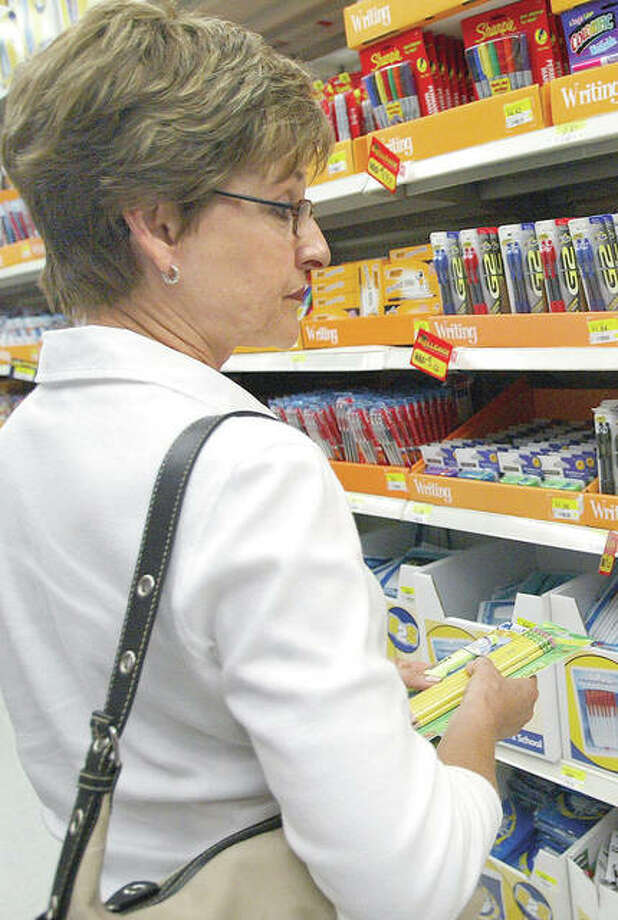 A teacher shops for supplies at a Walmart. Photo: Tim Boyle | Getty Images