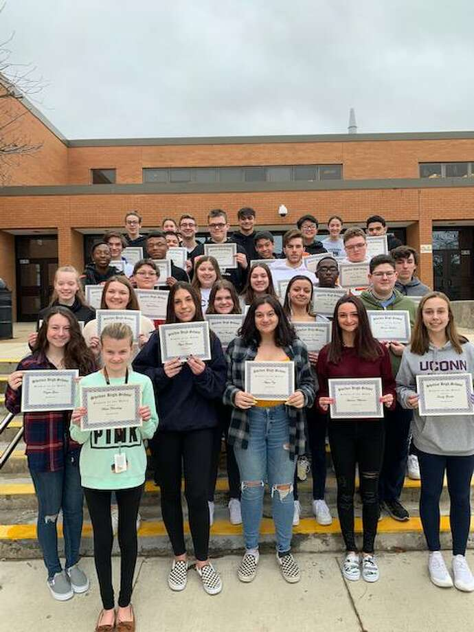 The Shelton High School December students of the month show off their certificates. Photo: Contributed Photo / Connecticut Post