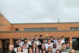 The Shelton High School December students of the month show off their certificates.