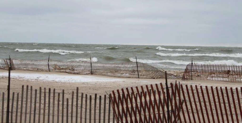 The high winds are damaging much of the snow fences at the beach and the high water levels are coming further up on the beach than in previous years. Photo: Ken Grabowski/News Advocate