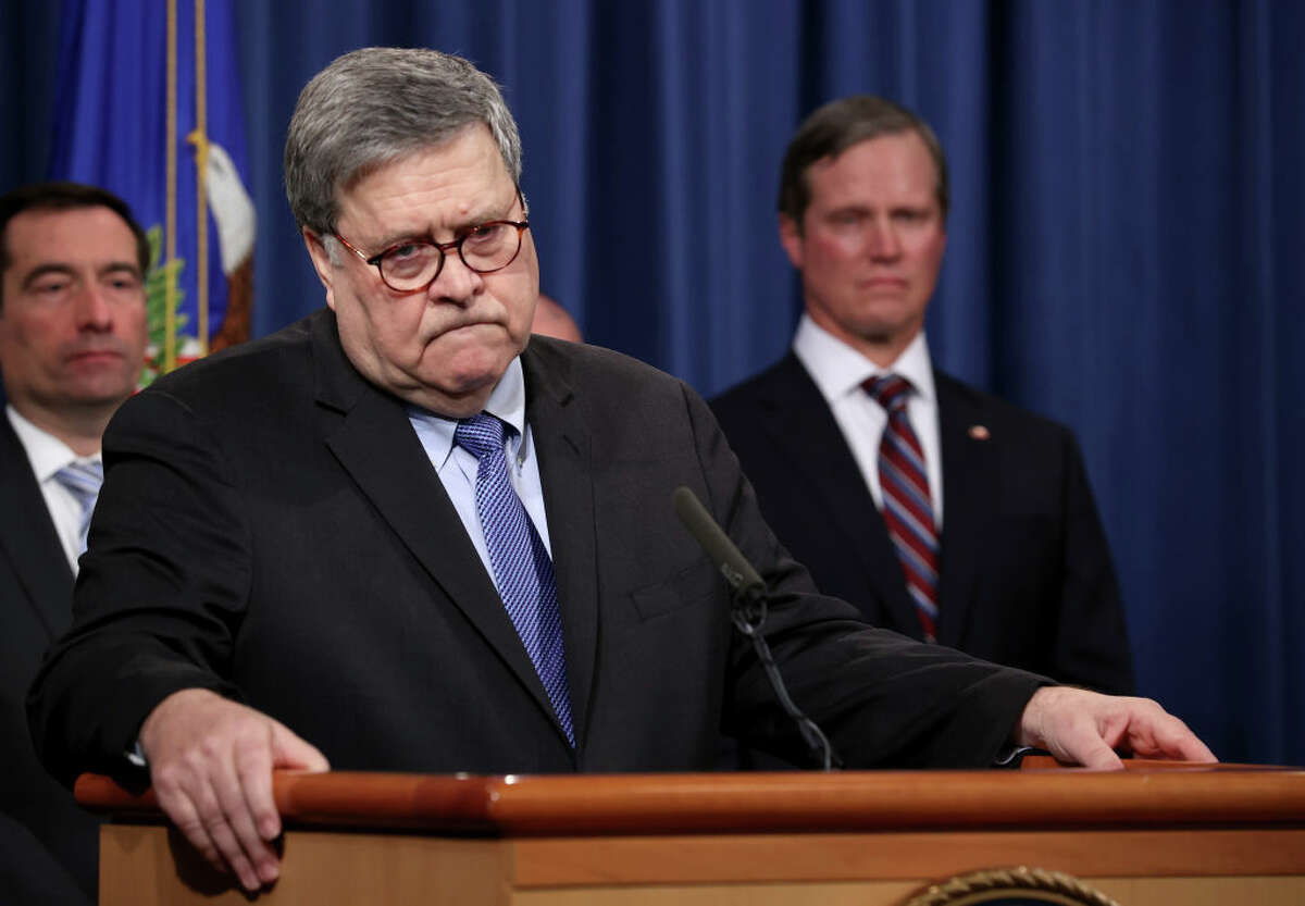 """WASHINGTON, DC - JANUARY 13: U.S. Attorney General William Barr (C) speaks during a press conference on the shooting at the Pensacola naval base January 13, 2020 in Washington, DC. Barr said the Justice Department's investigation determined the shooting """"was an act of terrorism"""" that was """"motivated by jihadist ideology"""". Barr said Apple has not provided """"substantive"""" assistance in accessing the shooter's iPhones, but Apple pushed back, saying it has provided """"gigabytes"""" of data."""