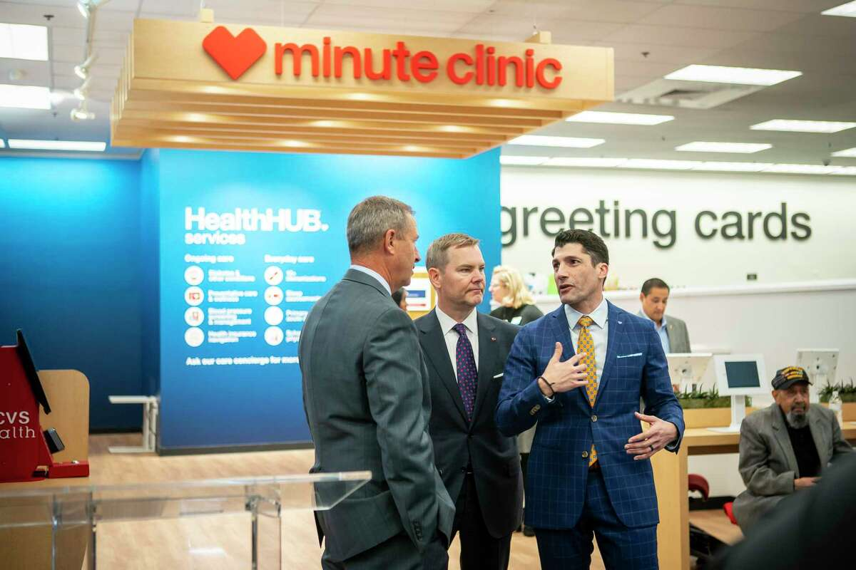 Texas House Rep. Jim Murphy and CVS Health Senior Vice Presidents Jeffrey Schmidt and Roger Francis speak before a ceremony celebrating the expansion of CVS's Minute Clinic concept into even more expanded HealthHub locations in 15 Houston-area store in the Galleria area on Monday, Jan. 13.