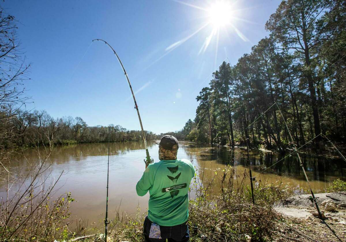 Derrick Taylork, of Huntsville, fishes in Stubblefield Lake in Sam Houston National Forest on Friday, Jan. 4, 2019, in New Waverly. The Trump administration plans to open the national forests and three others in East Texas to more oil and natural gas drilling.