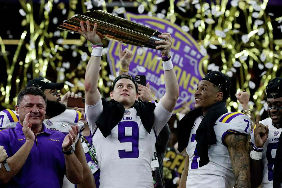 LSU quarterback Joe Burrow holds the trophy as safety Grant Delpit looks on after a NCAA College Football Playoff national championship game against Clemson, Monday, Jan. 13, 2020, in New Orleans. LSU won 42-25. (AP Photo/Sue Ogrocki) Photo: Sue Ogrocki, Associated Press / Copyright 2020 The Associated Press. All rights reserved
