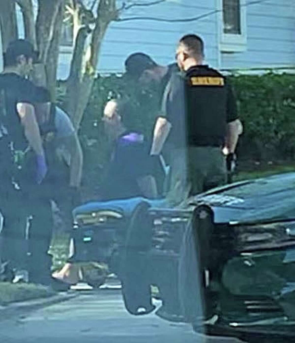 Neighbors in Celebration, Fla. say this is a photo of a man being arrested on Monday, Jan. 13, 2020 by Orange County sheriff deputies at a home where they are doing a death investigation. One neighbor says they had called police after not seeing the family's children for several days.