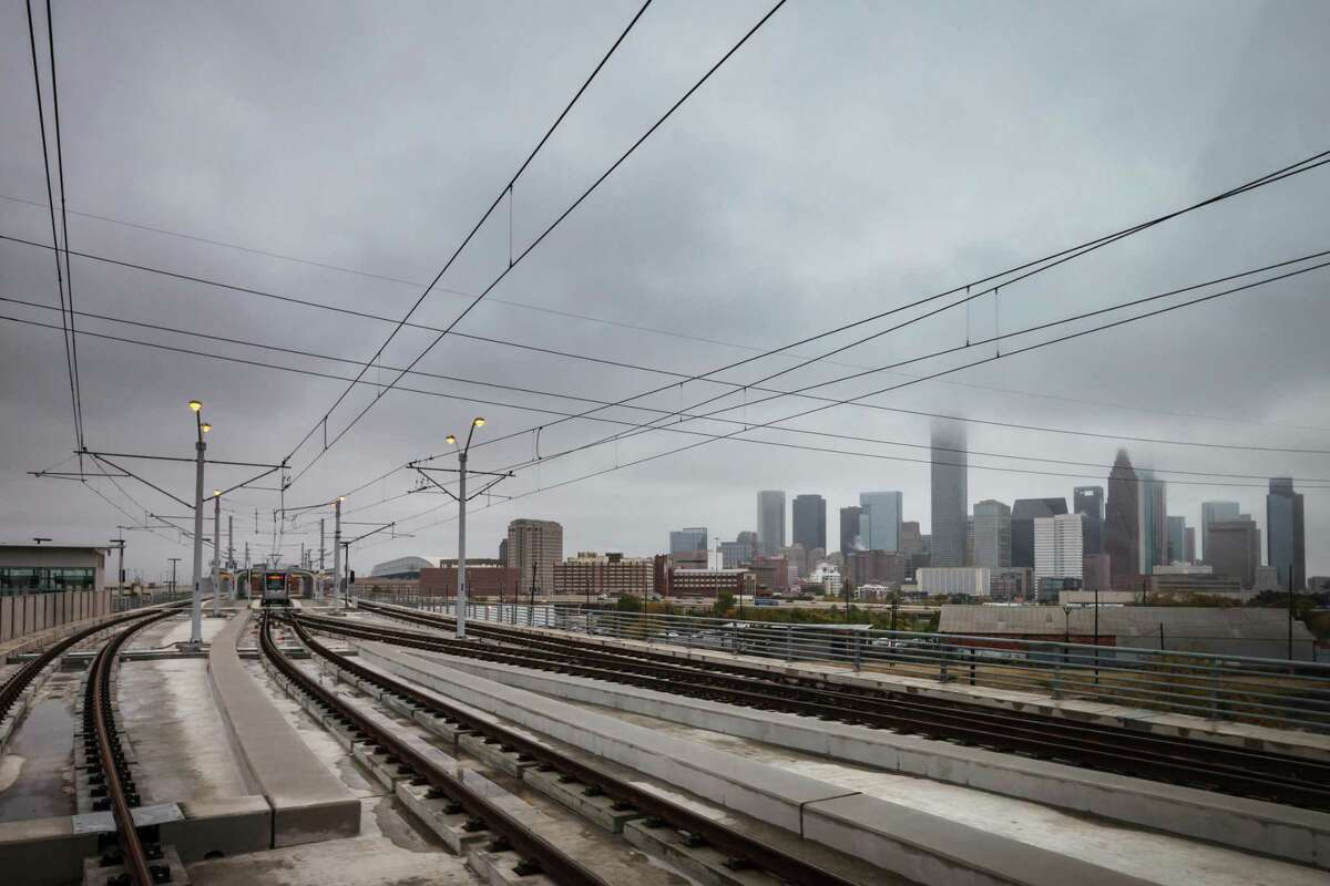 METRORail's Burnett Transit Center, near the site of the NRP mixed-income residential development, overlooks the downtown Houston Skyline while traveling on the North/Red Line. NEXT: What $15,000 rents in Houston, New York City & San Francisco