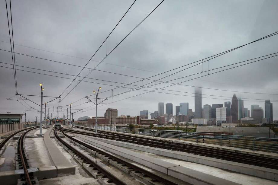 METRORail's Burnett Transit Center, near the site of the NRP mixed-income residential development, overlooks the downtown Houston Skyline while traveling on the North/Red Line. NEXT: What $15,000 rents in Houston, New York City & San Francisco Photo: Michael Paulsen, Staff / Houston Chronicle / © 2013 Houston Chronicle