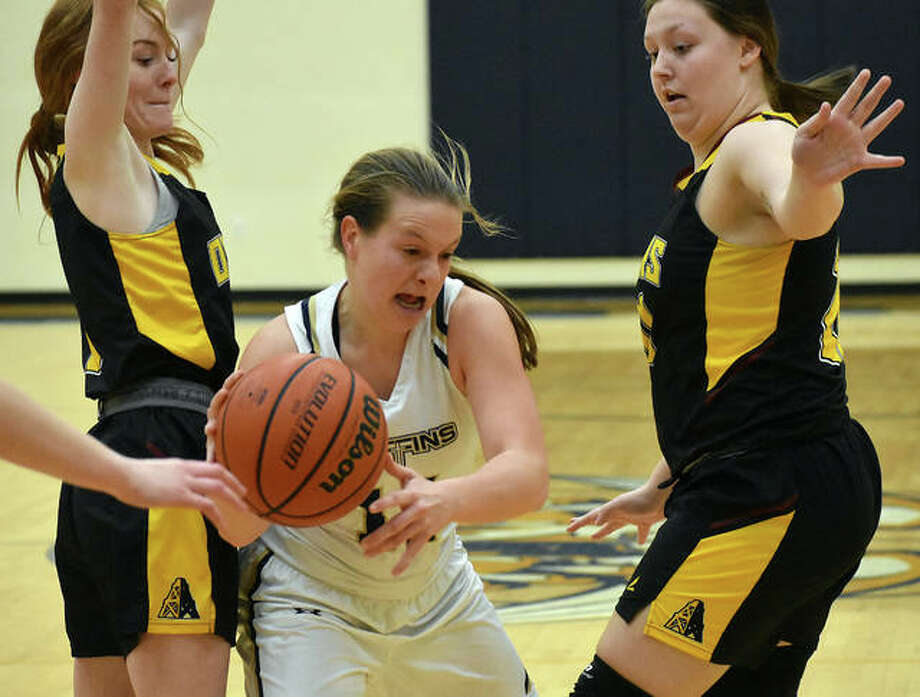 Father McGivney's Macy Hoppes looks to get out of a trap by EA-WR's LeighAnn Nottke (left) and Kayla Brantley on Monday in Glen Carbon. Photo: Matt Kamp | Hearst Midwest