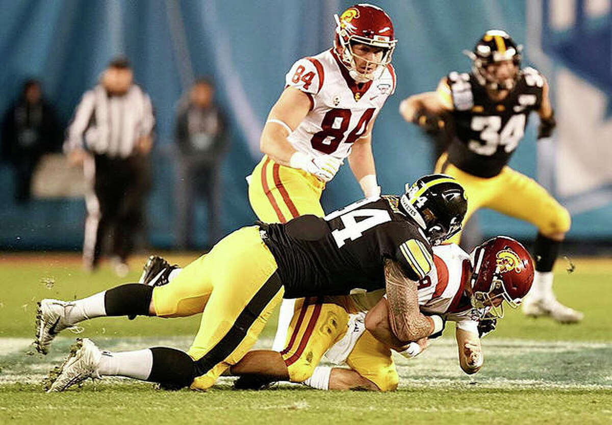Iowa defensive end AJ Epenesa records one of his 2.5 sacks in the Holiday Bowl in San Diego. Epenesa was named the game's Defensive MVP.