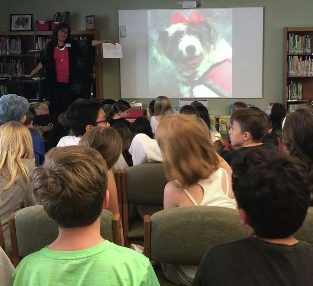 The Woodlands author Susan Langlois wants her new book, Dolly does her job, to possibly inspire other schools to get comfort dogs like Dolly to work with the students.