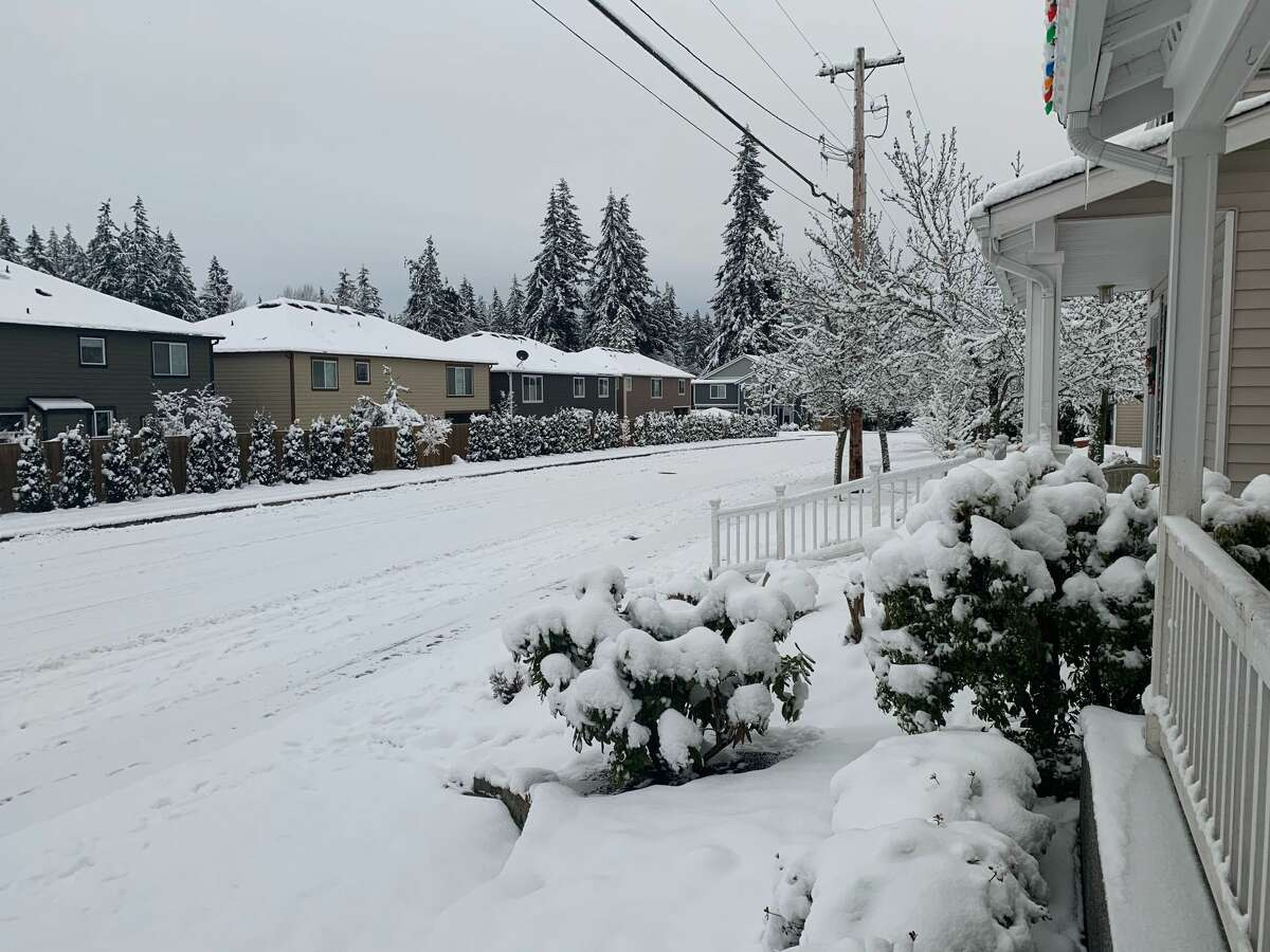 A snow-covered street in Mill Creek.