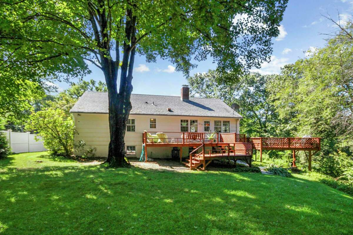Entertaining is enhanced by the three-quarters of an acre property and the large deck.