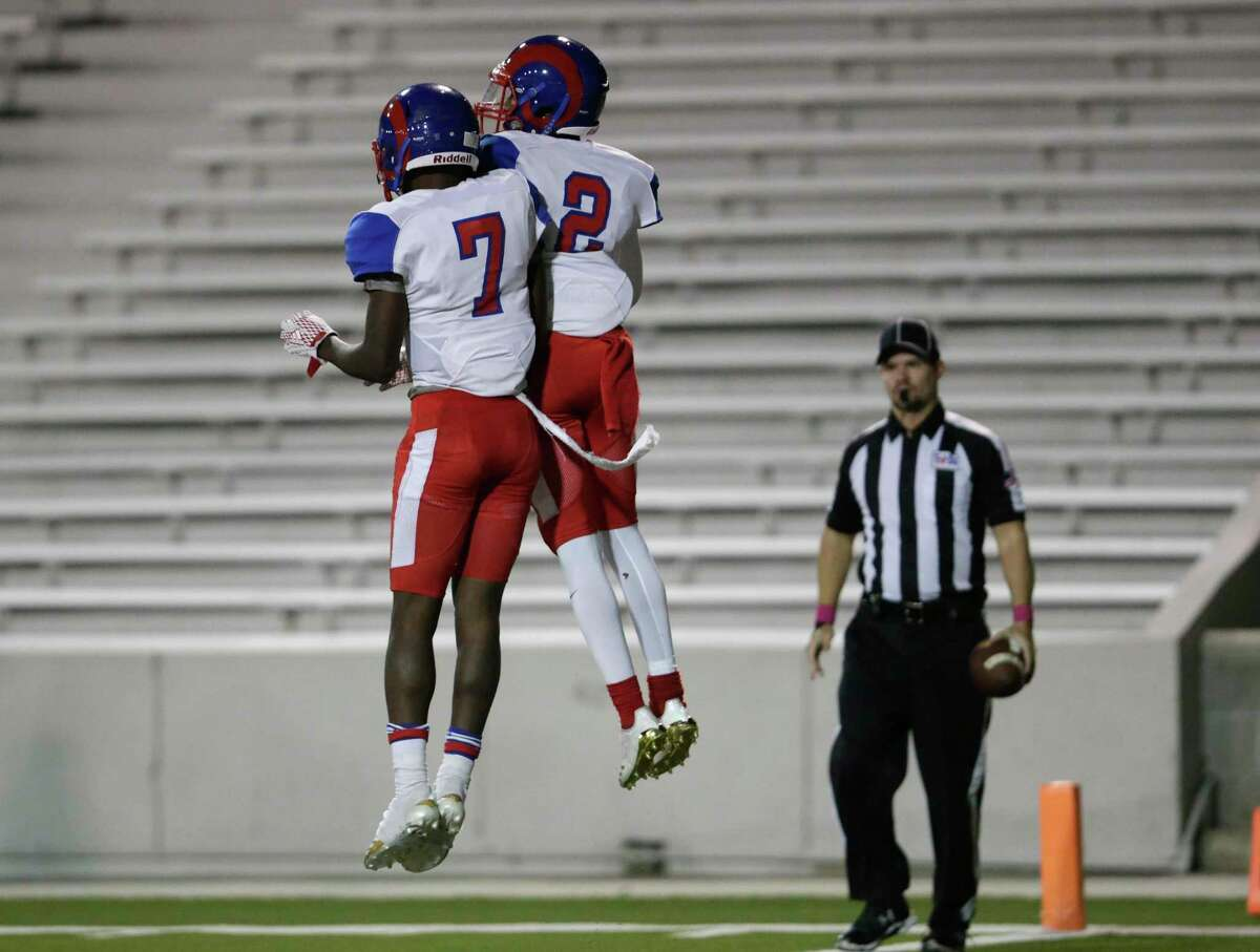 Kashmere Fighting Rams Damontae Boyd (7) and strong safety Aqunis Green (2) celebrate after a second half touchdown during the high school football game between Kashmere Fighting Rams and the North Forest Bulldogs at Delmar Stadium in Houston, TX on Thursday, October 26, 2017.