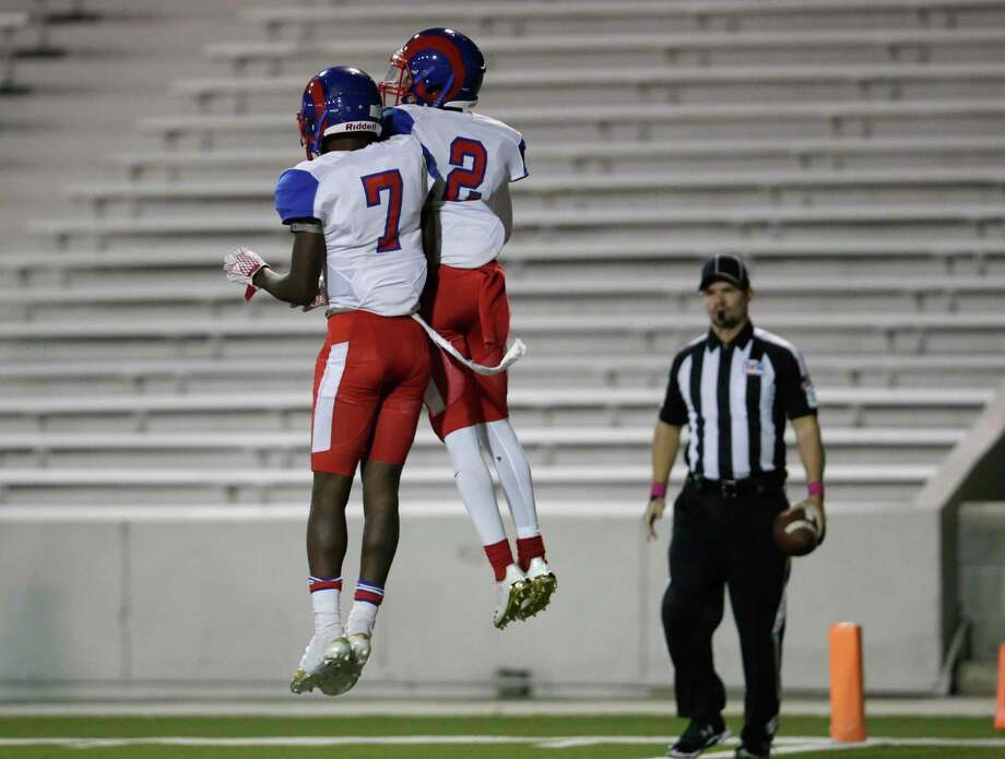 Kashmere Fighting Rams Damontae Boyd (7) and strong safety Aqunis Green (2) celebrate after a second half touchdown during the high school football game between Kashmere Fighting Rams and the North Forest Bulldogs at Delmar Stadium in Houston, TX on Thursday, October 26, 2017. Photo: Tim Warner, Freelance / For The Chronicle / Houston Chronicle