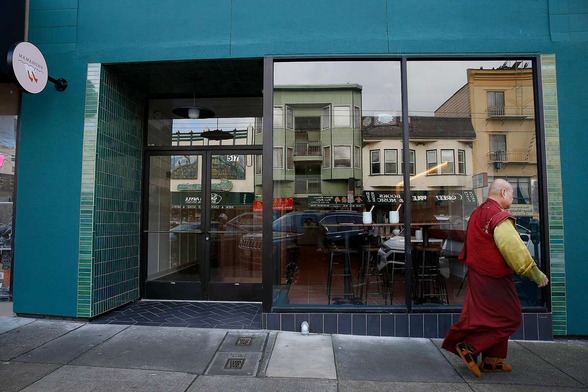 A pedestrian walks past Mamahuhu on Clement Street on Monday, January 13, 2020 in San Francisco, Calif.