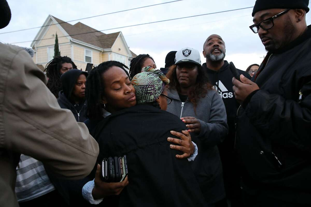 Carroll Fife, Director, Alliance of Californians for Community Empowerment, left, hugs Dominique Walker, co-founder of Moms 4 Housing. following an eviction from the Magnolia Street home she and other homeless mothers had been occupying in Oakland, Calif., on Tuesday, January 14, 2020. A judge ruled Friday that the homeless mothers didn't have the legal right to live on the property and would be evicted by the Sheriff's Office within days. The women said Friday they planned to stay, despite the eviction order.