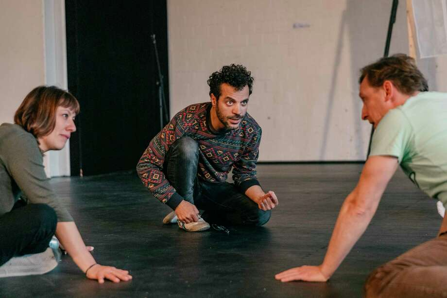 "Syrian director Rafat Alzakout, center, during a rehearsal of ""Death and the Maiden"" in October 2019 in Krefeld, Germany. Photo: Photo For The Washington Post By Felix Von Der Osten / For The Washington Post"