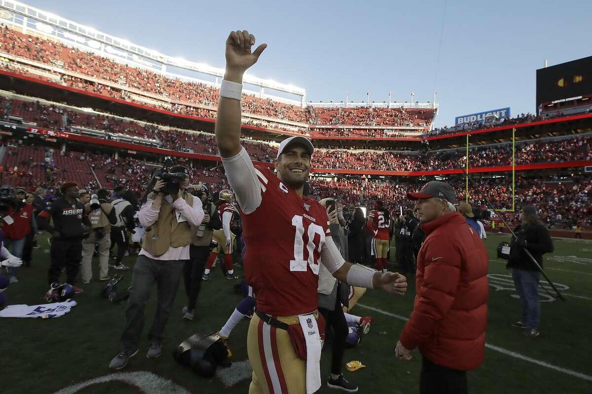 San Francisco 49ers quarterback Jimmy Garoppolo (10) celebrates after an NFL divisional playoff football game against the Minnesota Vikings, Saturday, Jan. 11, 2020, in Santa Clara, Calif. (AP Photo/Ben Margot)