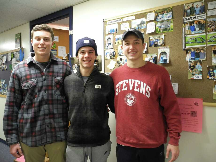 From left, Jack Savarese, Connor Burke and Jake Zeyher are this year's leaders of Socks for Soldiers at Wilton High School. Photo: Jeannette Ross / Hearst Connecticut Media / Wilton Bulletin