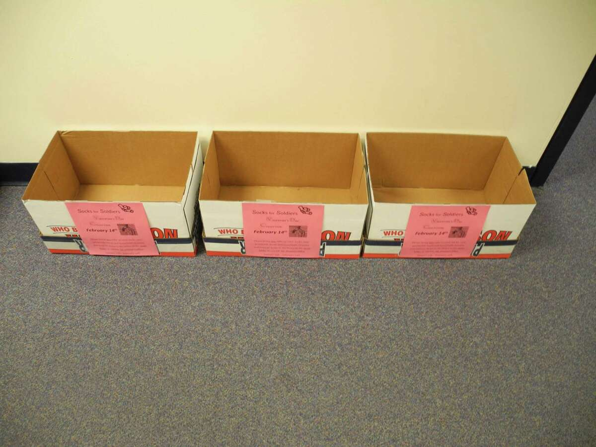 Empty boxes line the corridor outside guidance counselor Dann Pompa's office waiting for donations of new white socks, personal care items, non-perishable food and household cleaners. The Socks for Soldiers Valentine's Day drive ends Feb. 14.