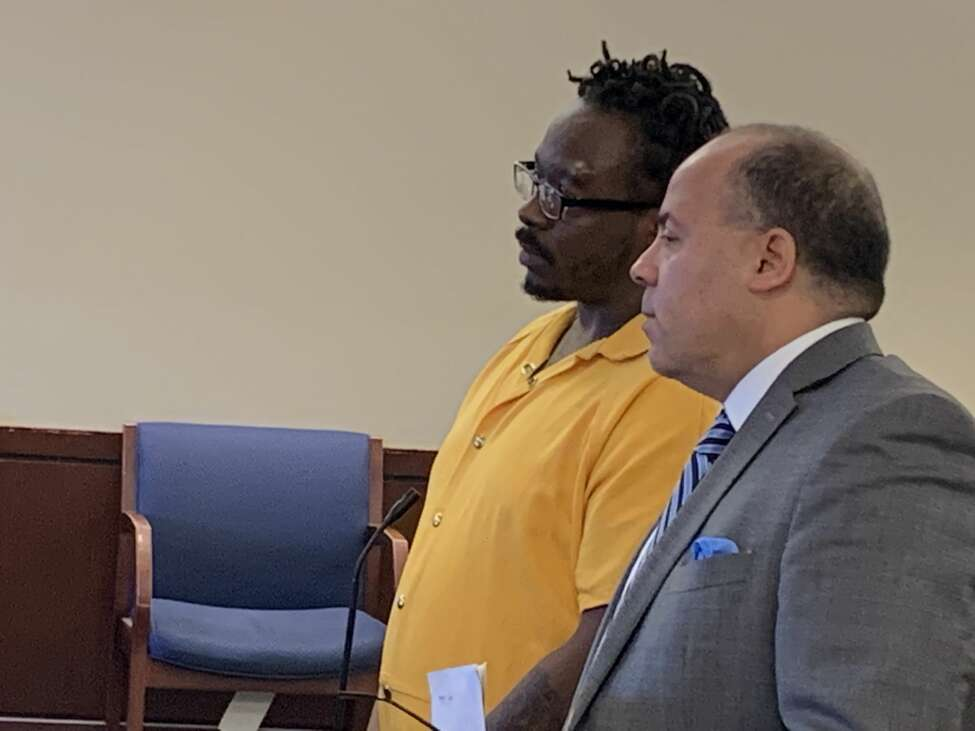 Tavon McCall, 28, of Selkirk stands beside attorney, Francisco Calderon, at his sentencing for animal neglect in the treatment of his late dog, Bella, who was found in a plastic bag.