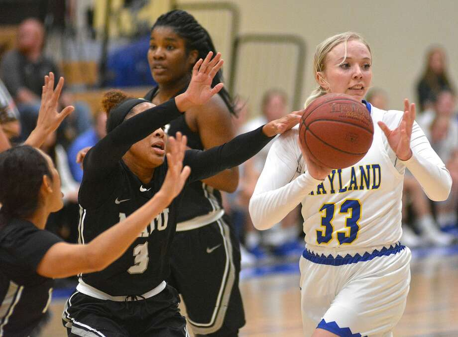 Wayland Baptist's Jenna Cooper looks to pass while being defended by Mid-America Christian's Rachel Tapps during their Sooner Athletic Conference women's basketball game on Thursday in the Hutcherson Center. Photo: Nathan Giese/Planview Herald