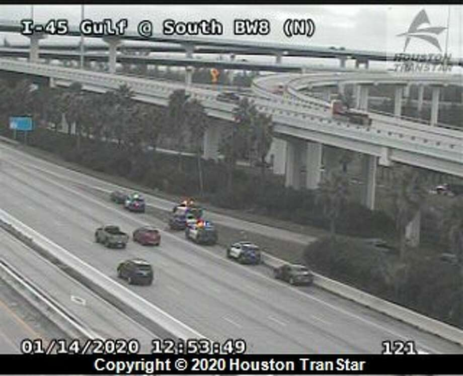 Houston police are seen on the Gulf Freeway near Beltway 8 after police say a man who was being detained for walking along the freeway suddenly stopped breathing and later died Tuesday, Jan. 14, 2020. Photo: Houston TranStar