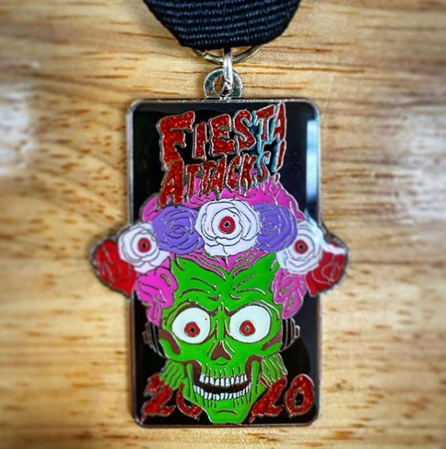 "After moving to San Antonio four years ago from Austin, Christopher Edwards has joined the Fiesta madness with a nostalgic, 90s ""Mars Attacks!"" medal. Photo: Instagram: Misterchexty"