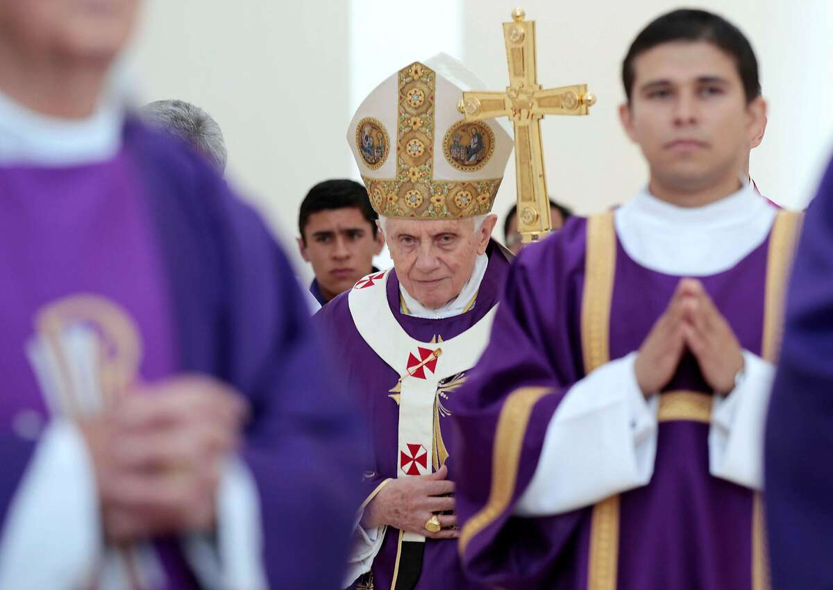 Pope Benedict XVI walks with his pastoral staff prior to the start of Sunday Mass in Bicentennial Park near Silao, Mexico, Sunday March 25, 2012. (AP Photo/Gregorio Borgia)