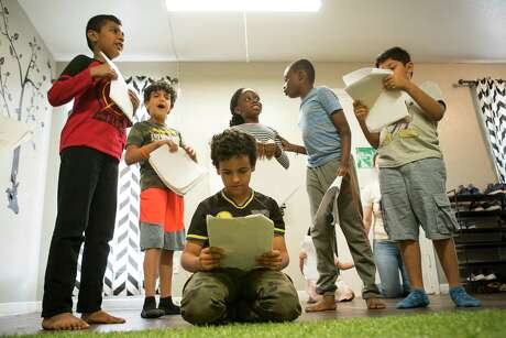 Ahmed Alolofi, 10, studies his lines while he and his fellow rehearse a play at CHAT, a non-profit organization that supports Houston's immigrant and refugee community. On Friday, Gov. Greg Abbott declined to resettle any refugees in Texas for 2020.