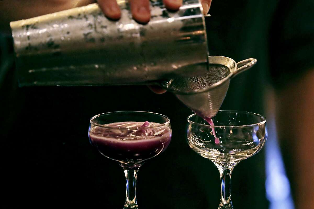In this Dec. 10, 2019, photo cocktails are crafted at Wink & Nod, basement-dwelling, speakeasy-like bar, in Boston. Americans are consuming more alcohol per capita now than in the time leading up to Prohibition, when alcohol opponents successfully made the case that excessive drinking was ruining family life. (AP Photo/Charles Krupa)