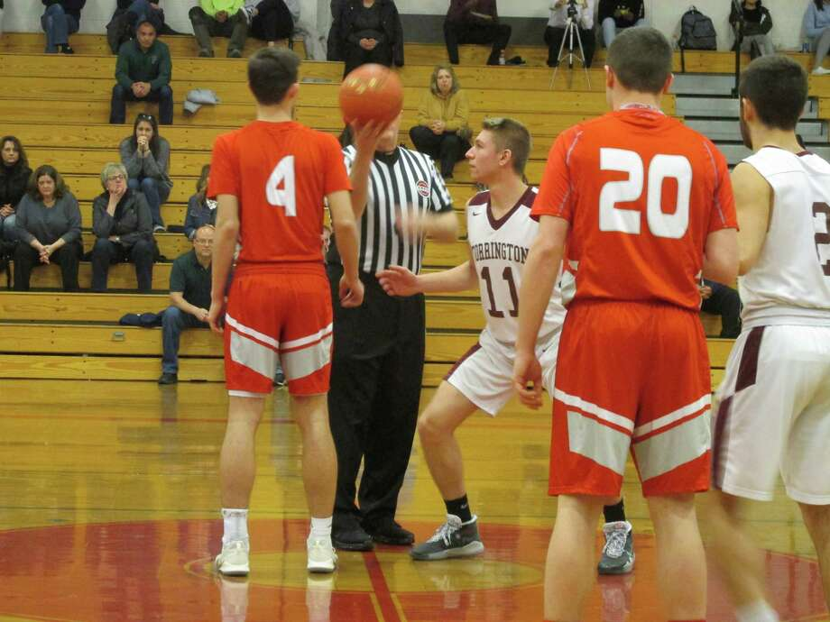 Torrington's T.J. Calabrese (11) led the Red Raiders past Wolcott while evening their NVL record Monday night at Torrington High School. Photo: Peter Wallace / Hearst Connecticut Media