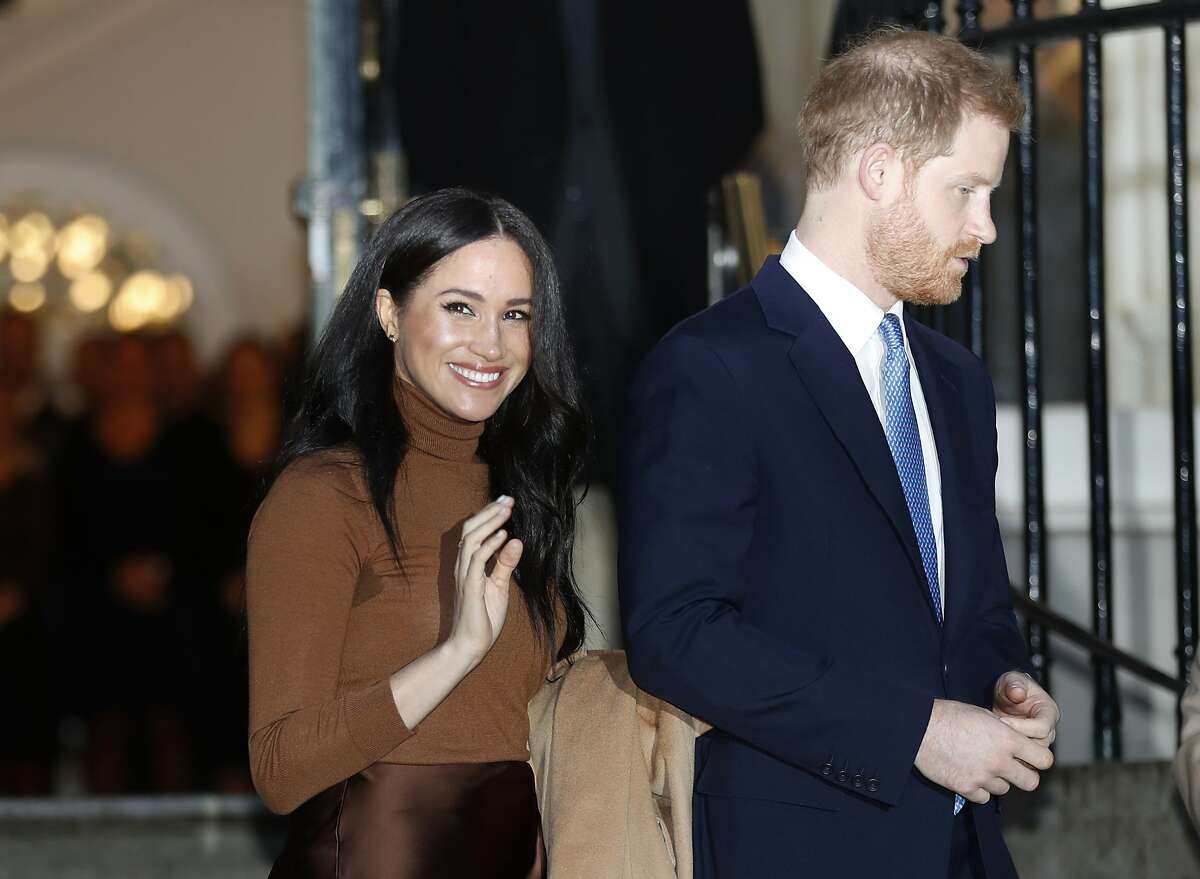 FILE - In this Jan. 7, 2020, file photo, Britain's Prince Harry and Meghan, Duchess of Sussex leave after visiting Canada House in London, after their recent stay in Canada. As Prince Harry and Meghan step back as senior royals, questions linger over the role race has played in her treatment in Britain. (AP Photo/Frank Augstein, File)