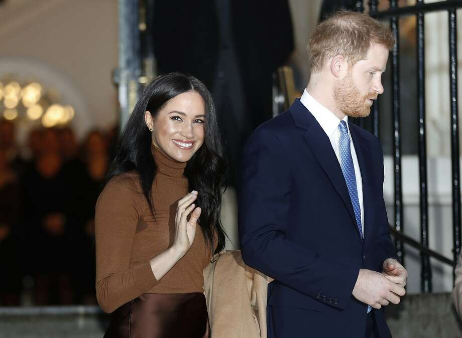 FILE - In this Jan. 7, 2020, file photo, Britain's Prince Harry and Meghan, Duchess of Sussex leave after visiting Canada House in London, after their recent stay in Canada. As Prince Harry and Meghan step back as senior royals, questions linger over the role race has played in her treatment in Britain. (AP Photo/Frank Augstein, File) Photo: Frank Augstein, Associated Press