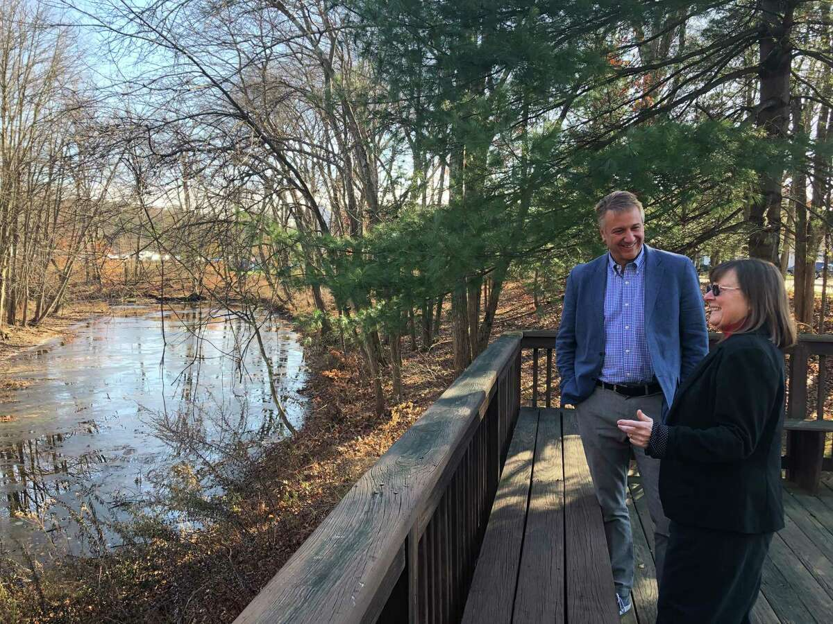 Elim Park retirement community and the Cheshire Land Trust have teamed up to protect the wildlife, habitats and water quality on property in Cheshire. Above,Brian Bedard, CEO of Elim Park and Karen Schnitzer of the Cheshire Land Trust, survey the recent Mill River improvements.