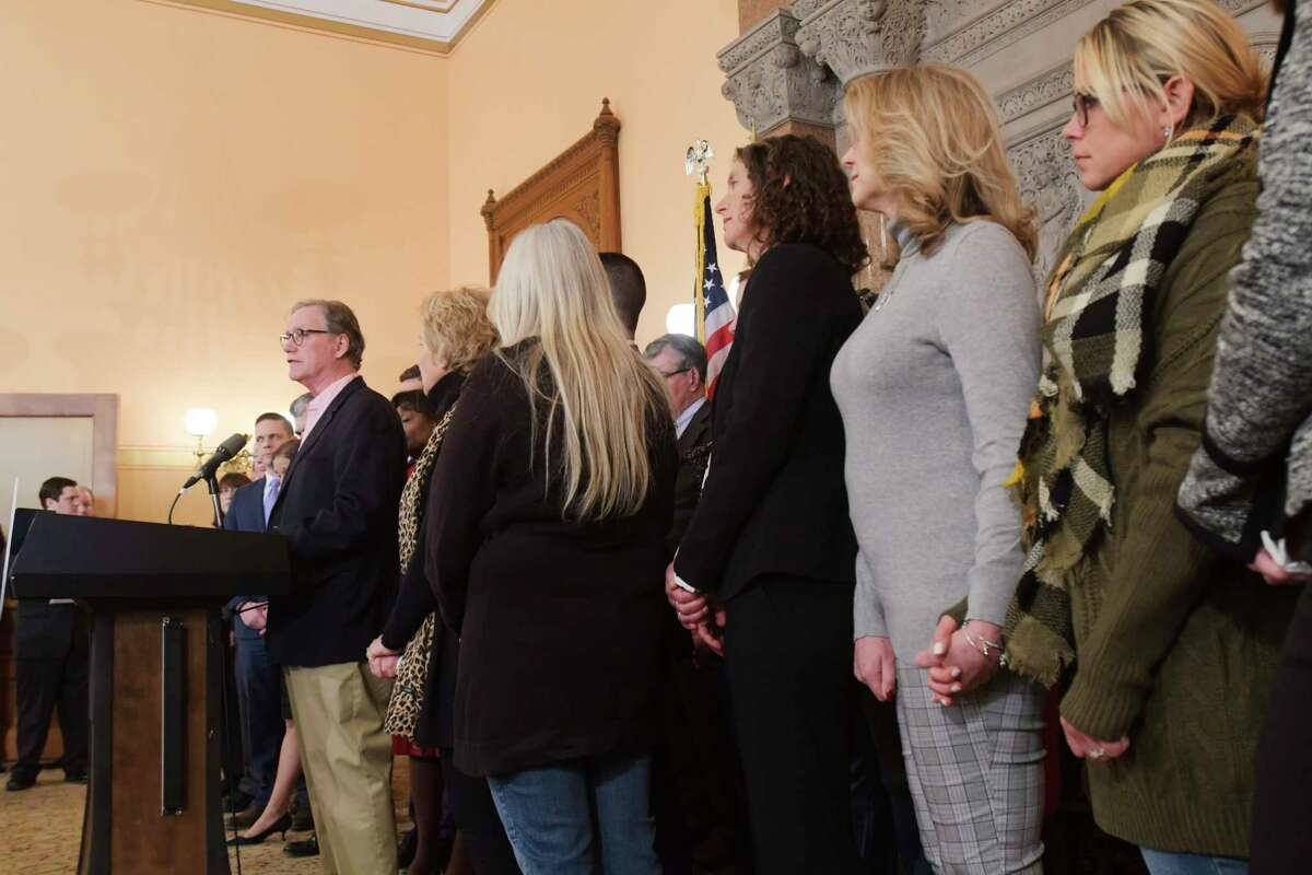 Families who lost loved ones in the Schoharie limo crash look on as Kevin Cushing, at podium, speaks at a press conference at the Capitol about new limo safety regulations on Tuesday, Jan. 14, 2020, in Albany, N.Y. Kevin Cushing lost his son Patrick Cushing in the Schoharie limo crash. (Paul Buckowski/Times Union)