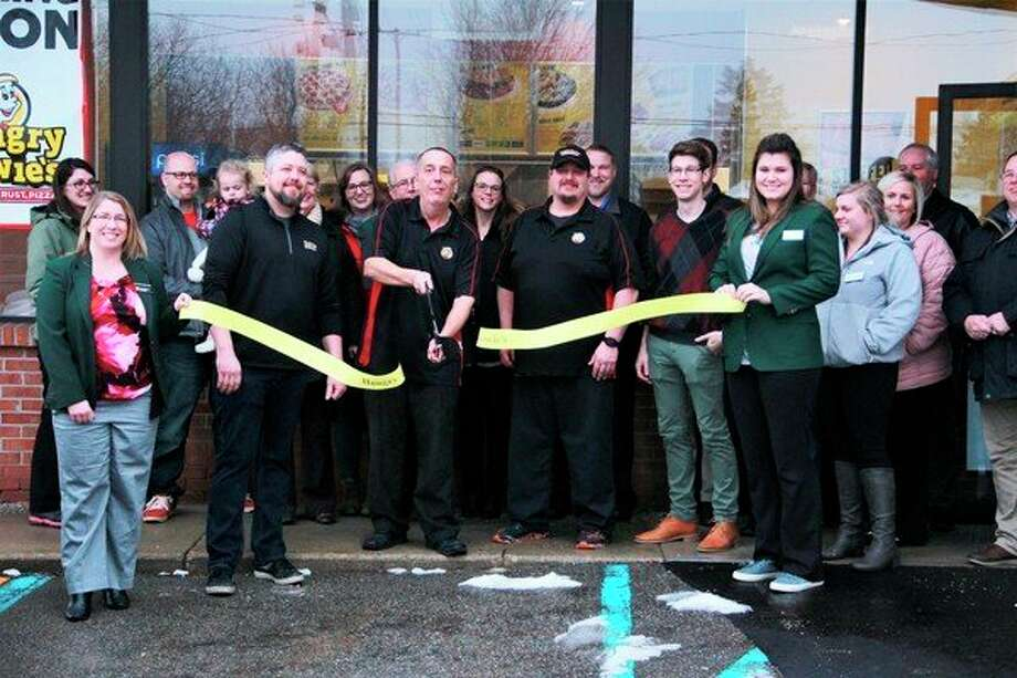 Hungry Howie's was welcomed by city officials and business owners Tuesday morning during their VIP ribbon cutting party. During the gathering, guests had the opportunity to meet the new store owners while sampling a variety of menus items. (Pioneer photo/Alicia Jaimes)
