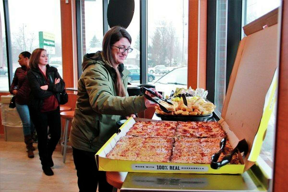 After the VIP ribbon cutting, guests were invited to sample a few items provided on the Hungry Howie's catering list. (Pioneer photo/Alicia Jaimes)