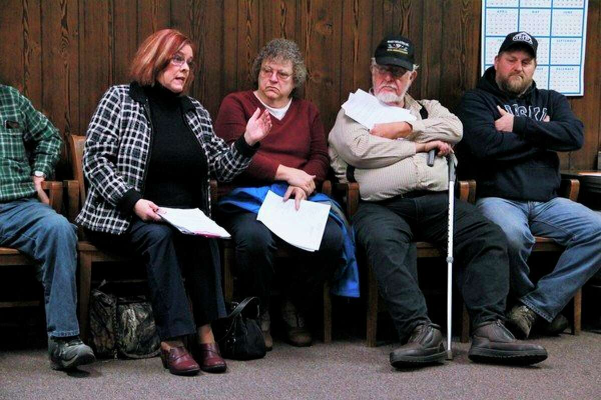 The board room was full as Austin Township residents awaited the Mecosta County Road Commission's vote on whether or not to keep the stop signs on 8 Mile Road and 170th Avenue. (Pioneer photo/Alicia Jaimes)