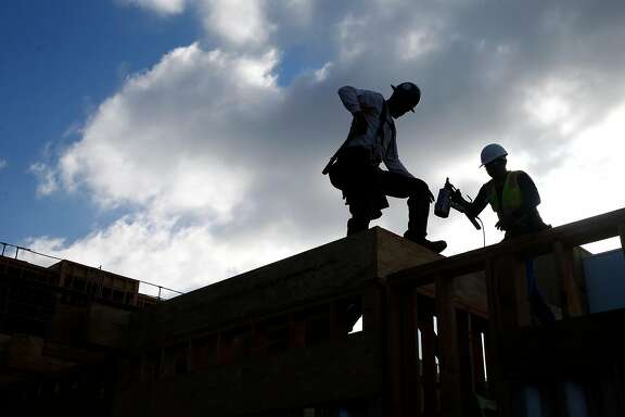 Construction workers build condominiums at the Ice House development by City Ventures in Oakland, Calif. on Thursday, June 27, 2019..