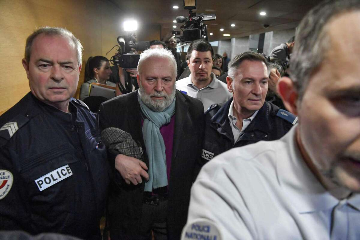 Bernard Preynat, a French former priest accused of sexual assaults, leaves a Lyon courthouse.