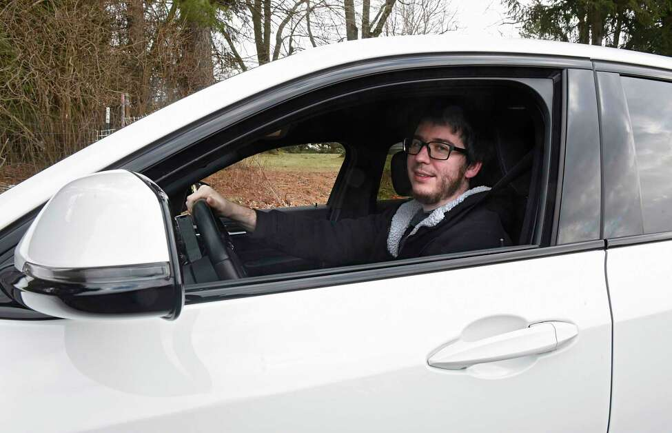 Kraig Roche, a driver for Uber and Lyft, is seen in his car on Tuesday, Jan. 14, 2020 in Albany, N.Y. Roche is the founder of a private Facebook group consisting of ride-share drivers from across the Capital Region. (Lori Van Buren/Times Union)