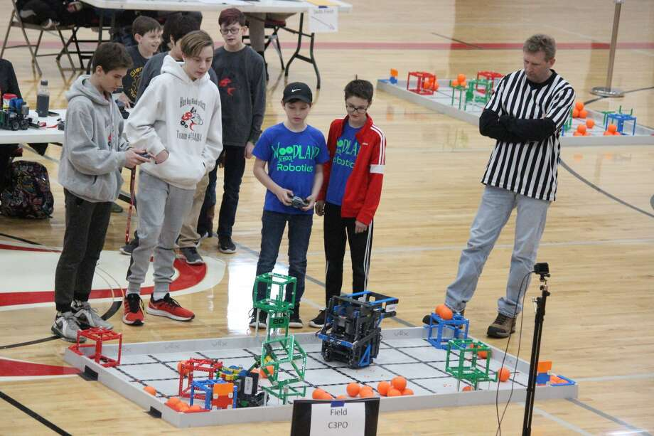 Students from Benzie Central and Woodland work together to rack up points while teamed up in the robotics competition. Photo: Robert Myers