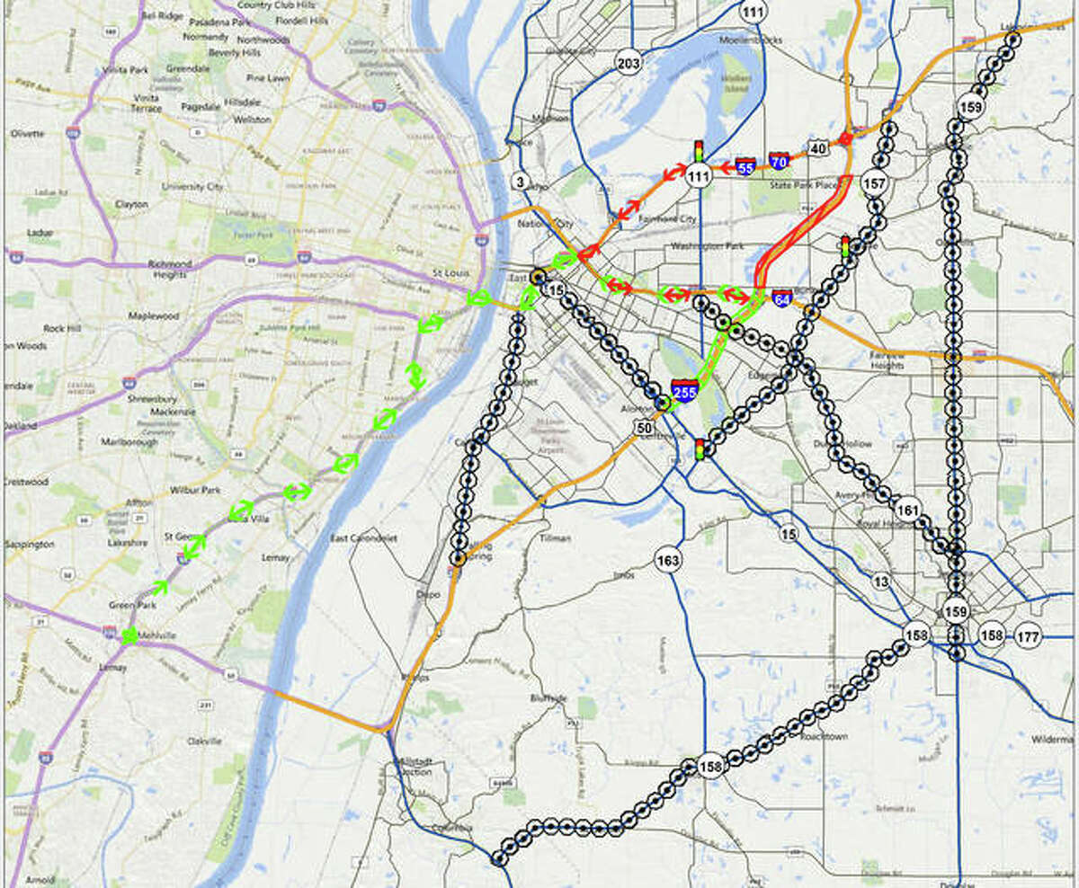 According to the IDOT map, the following symbols are: the red zone with diagonal markings indicates the North Work Zone; the green zone with diagonal markings indicates the South Work Zone; the red arrows mark the North Detour; the green arrows mark the South Detour; the black dots within octagons represent alternate routes.