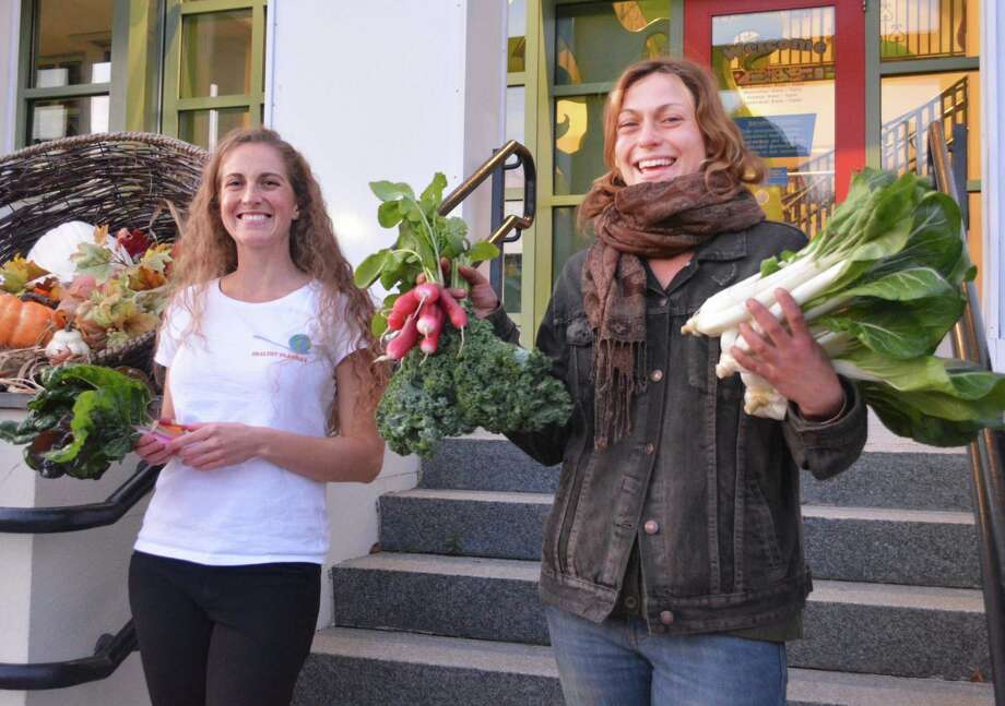 In late October, Wesleyan professor Rosemary Ostfeld, an interdisciplinary environmental scientist, founded Healthy PlanEat, a Middletown start-up which allows farmers to sell their produce to local buyers. Ostfeld recently launched a Kickstarter campaign with a goal of raising $40,000 to create a smartphone app. She's shown with Jen Hill, assistant manager of Star Light Farms in Durham. Photo: Hearst Connecticut Media File Photo
