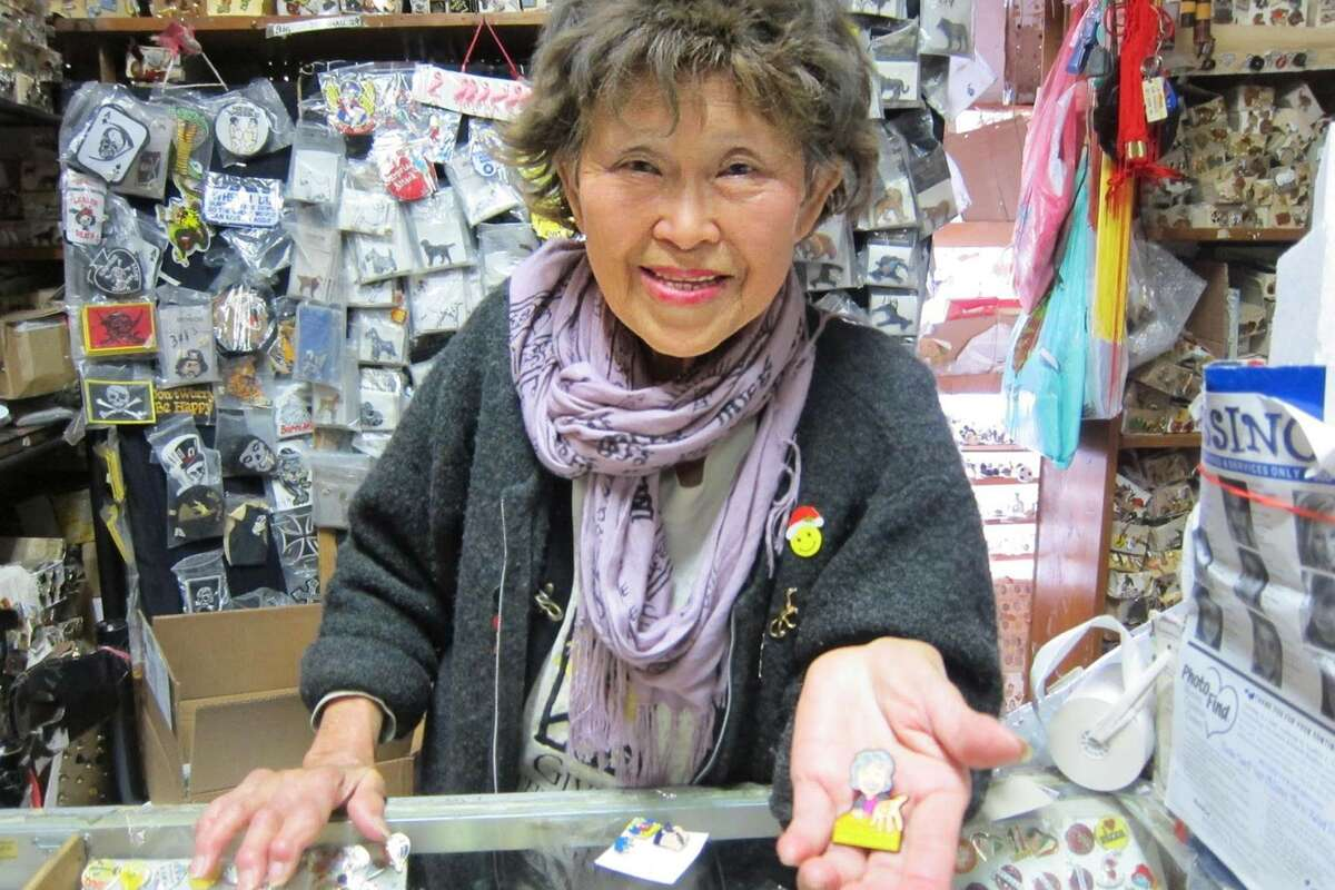 FILE - Su Lee is the proprietor behind the Oriental Art Gallery: a tiny shop on 9th and Irving boasting a massive assortment of enamel pins and other quirky wares. Over the weekend, San Francisco residents raised $15,000 to save the shop during its extended closure.