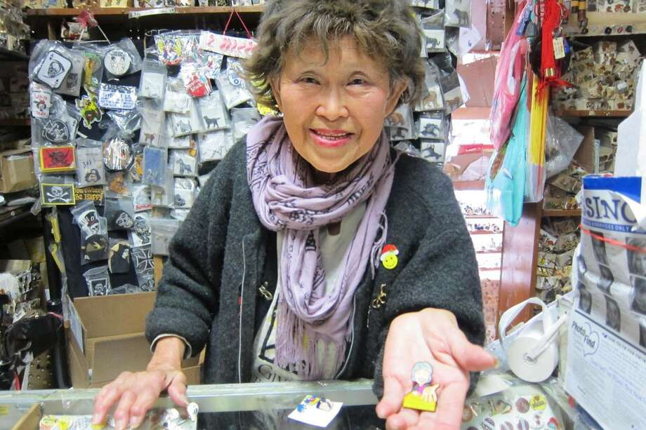 FILE - Su Lee is the proprietor behind the Oriental Art Gallery: a tiny shop on 9th and Irving boasting a massive assortment of enamel pins and other quirky wares. Over the weekend, San Francisco residents raised $15,000 to save the shop during its extended closure. Photo: Josh Ellingson