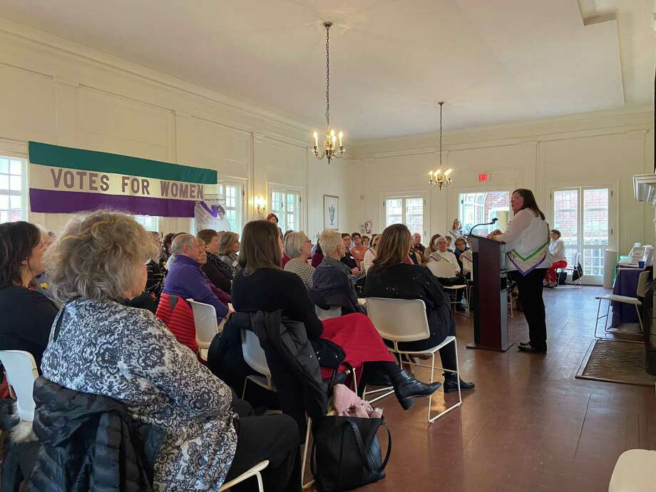 Marilyn Carroll, president of League of Women Voters of Ridgefield, delivers the opening remarks at the League's Alice Paul Day celebration on Tuesday, Jan. 14. Photo: Stephen Coulter / Hearst