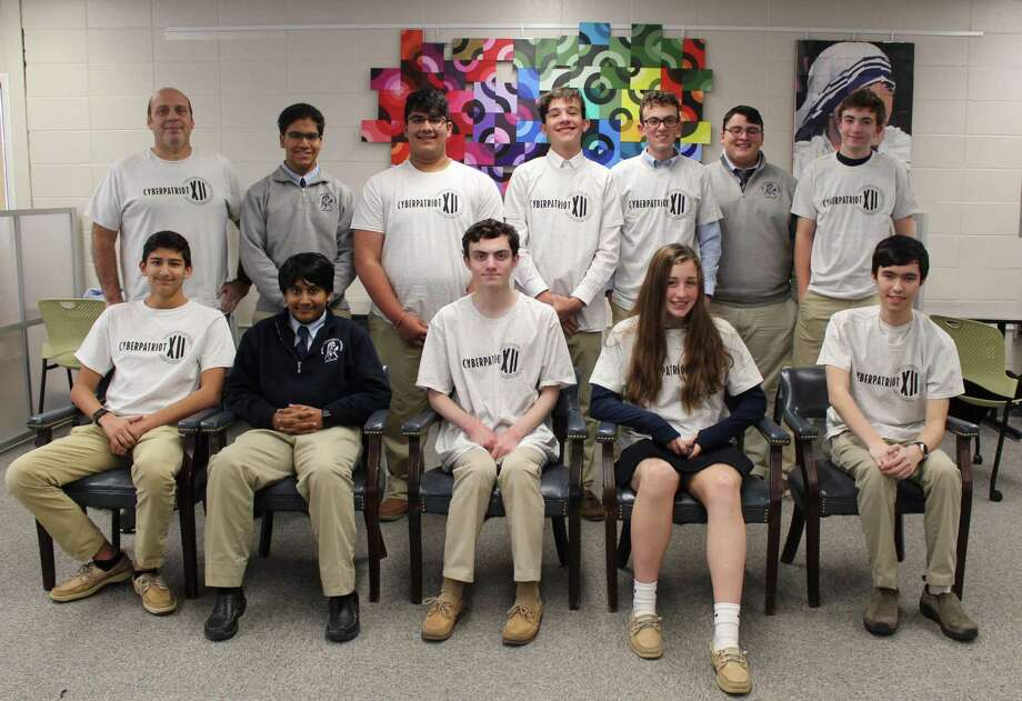 The Immaculate High School CyberPatriots recently placed first in the Platinum Division in the Connecticut Regional National Youth Cyber Defense Competition sponsored by the National Cyber Education Program. Above are, from left to right, in front, Perry Ghosh, Aiden Doolabh, Andrew Riotto, Lauren Manning and James Mok and, in back, Dave Cirella, Kieran Doolabh, Anish Nanda, Ricky Lawlor, Logan McAloon, Kolbe Mosher and Ethan Goodman. Missing is Steven Reese. Photo: Courtesy Of Immaculate High School / The News-Times Contributed