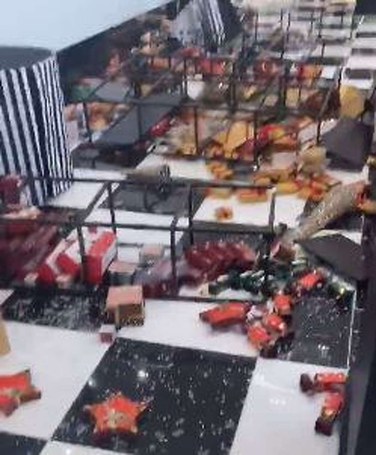 Display cases are toppled over in Bloomingdale's at The SoNo Collection on Monday night.